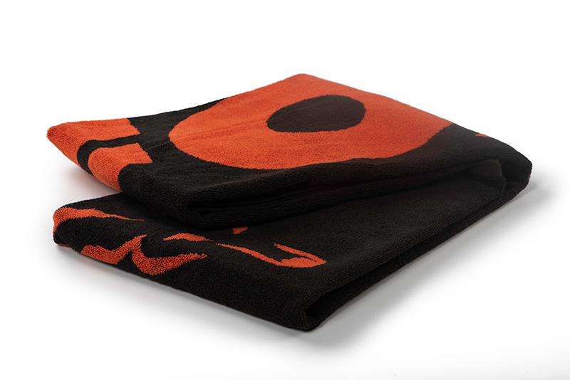 cll176_fox_beach_towel_black_orange_foldedjpg